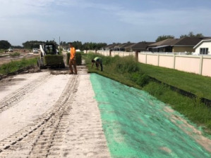Installing erosion mat and sod along the new roadway construction (July 29, 2020 photo)