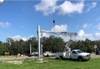 Installing mast arms for new traffic signals in the southeast corner of US 41 and Ayers Road (July 15, 2020 photo)