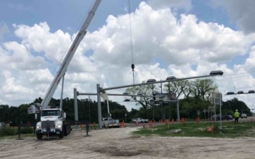 Installing mast arms for new traffic signals in the southwest corner of US 41 and Ayers Road (July 15, 2020 photo)