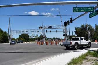 Traffic goes through the intersection of Sam Allen Road and Paul Buchman Highway. Eastbound Sam Allen is closed at the intersection. (4/28/2020 photo )