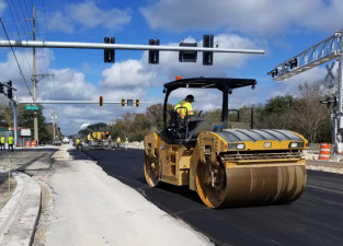 Paving the reconstructed intersection of Sam Allen Road and Buchman Highway in preparation to reopen the roadways in January 2020
