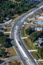 Looking northwest at US 19 (Yulee Drive is at the bend). Widening is nearing completion. (December 8, 2020 photo)