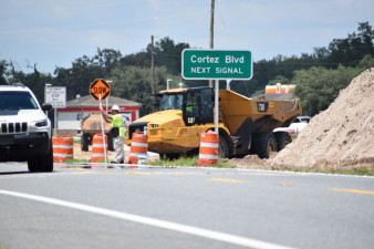 Workers control traffic for equipment crossings on US 301 south of SR 50 (7/17/2020 photo)