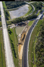 Crews build a drainage pond between the southbound lanes of I-75 and the new 2-lane ramp to I-4.
