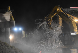 Cleanup of demolished bridge steel (2/14/2021 photo)