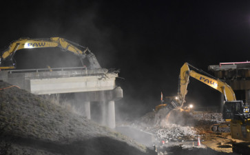 Cleanup of demolished bridge materials (2/14/2021 photo)