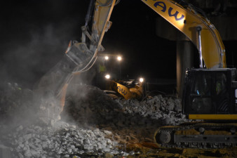 Cleanup of demolished bridge concrete (2/14/2021 photo)