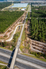 Looking east at Overpass Road over I-75. To the left, clearing is taking place for the realignment of McKendree Road to connect to Boyette Road across from the water treatment plant. (December 13, 2020 photo)