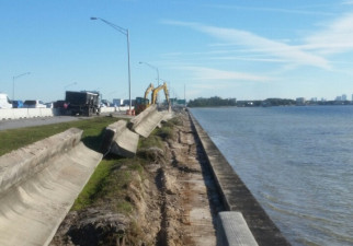 Working on the seawall on the south side of I-275 east of the Howard Frankland Bridge