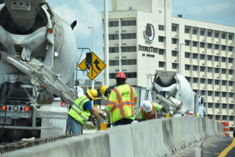 Workers place concrete between the West Shore Boulevard entrance ramp and the northbound I-275 lanes (3/16/20 photo)