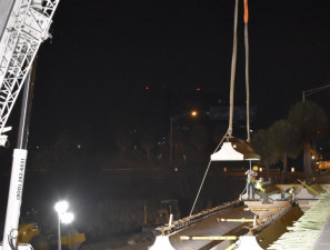 A beam is lowed into place by crane and guided by workers at I-275 over SR 60 (3/21/2020 photo)