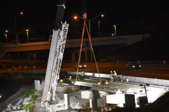 Crews were busy in the early morning installing concrete beams at I-275 over SR 60 (3/21/2020 photo)