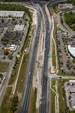 Looking west over SR 56 at work in the median and northbound interchange ramps (3/15/2021 photo)