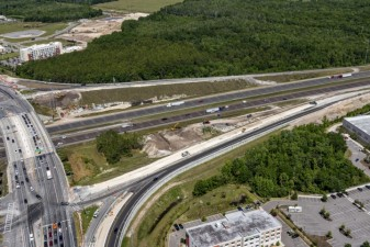Looking northwest over SR 56 (left side) at I-75 ramp construction (4/14/2021 photo)