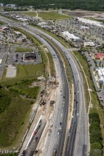 Looking west over SR 56 at construction of the eastbound SR 56 ramp onto southbound I-75 (4/14/2021 photo)