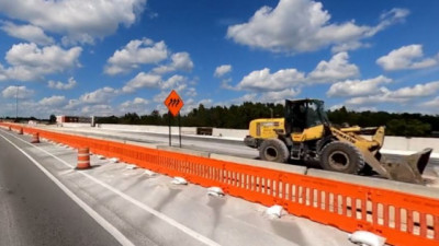 New pavement construction on the north side of SR 56 approaching I-75